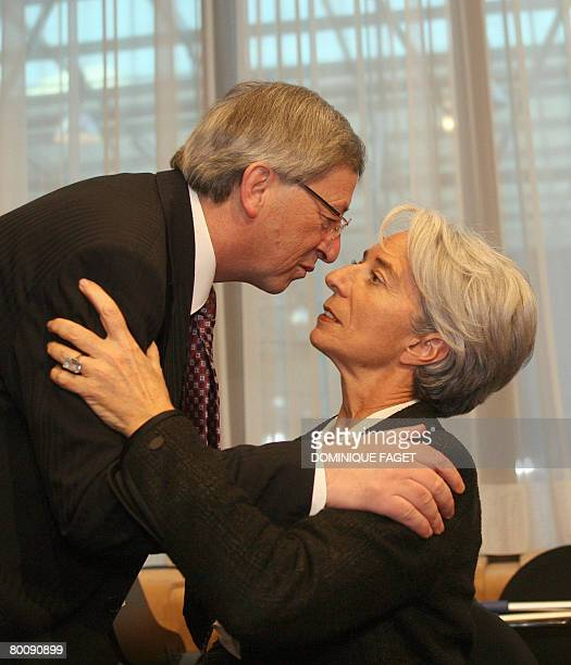 French Finance Minister Christine Lagarde kisses Luxembourg Prime Minister JeanClaude Juncker before a Eurogroup council on March 3 2008 at the...
