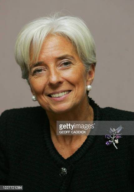 French Finance Minister Christine Lagarde smiles during a press conference following the G20 Finance Ministers meeting in St Andrews in Scotland on...
