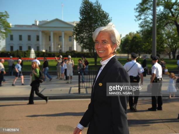 French Finance Minister Christine Lagarde walks past the White House on Pennsylvania Ave after attending an agreement signing between the French...