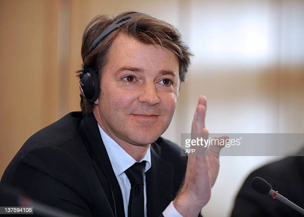 French Finance Minister Francois Baroin listens during a press conference following a meeting of the Franco-German Economic and Finance council with...