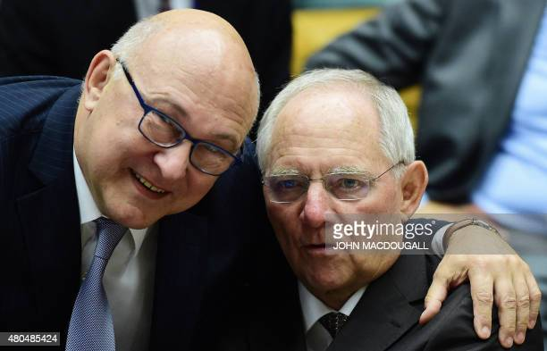 French Finance Minister Michel Sapin greets German Finance Minister Wolfgang Schaeuble during a meeting of the Eurogroup finance ministers in...