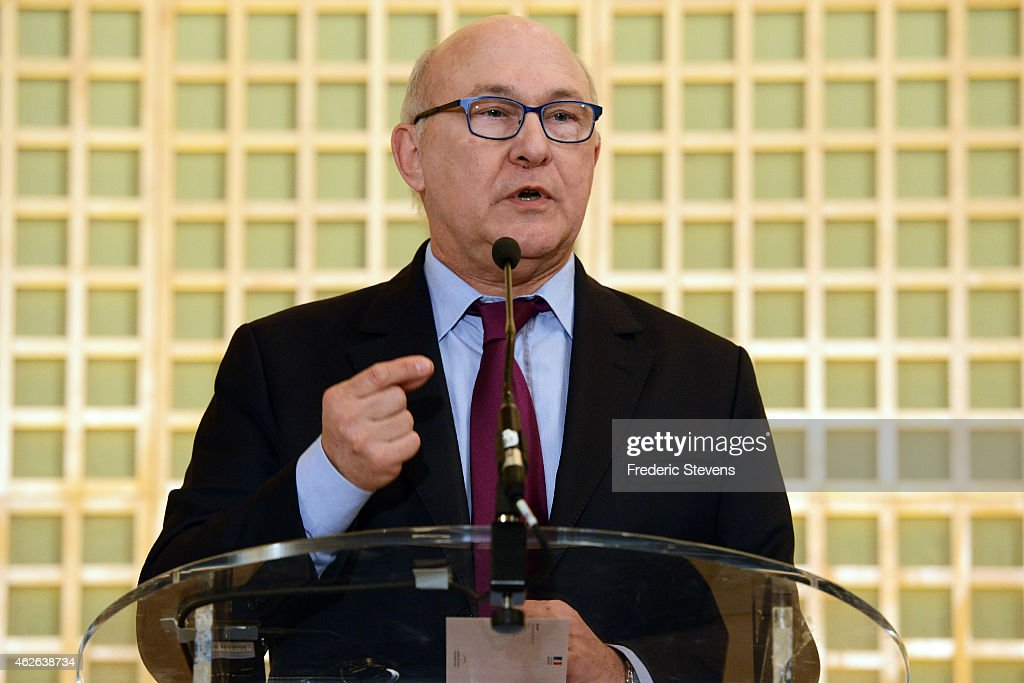 French Finance Minister Michel Sapin speaks during at a press conference with Greek Finance Minister Yanis Varoufakis following their meeting at the French Finance Ministry on February 1, 2015 in Paris, France. Yanis Varoufakis is on a two-days visit to Paris to launch the Greek new anti-austerity government's search for EU allies.
