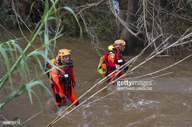 French firefighter divers search for a missing person near a river on November 28 2014 in La LondelesMaures southeastern France after a violent storm...