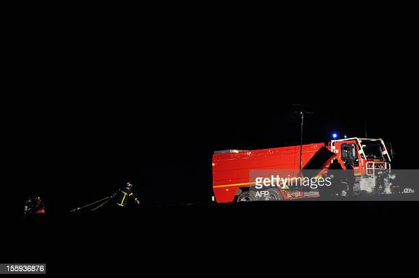 French firefighters work at the scene of the accident where an Algerian military cargo plane travelling with six people on board from Paris to...