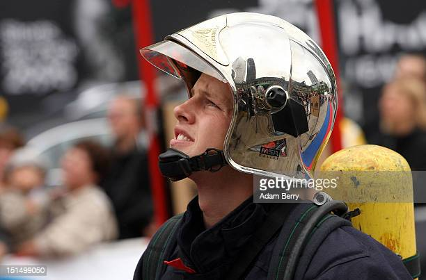 French fireman watches another contestant during the 6th Firefighter Combat Challenge on September 8 2012 in Berlin Germany The Firefighter Combat...