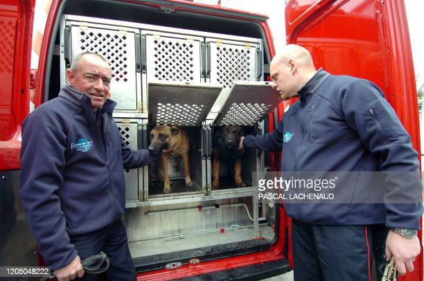 French firemen and dog handlers load their truck on April 7, 2009 in Limoges, southern France, prior to their departure to Italy to join the rescue...