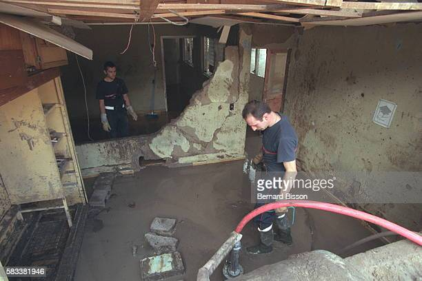 French firemen pumping water from a flooded building in the capital