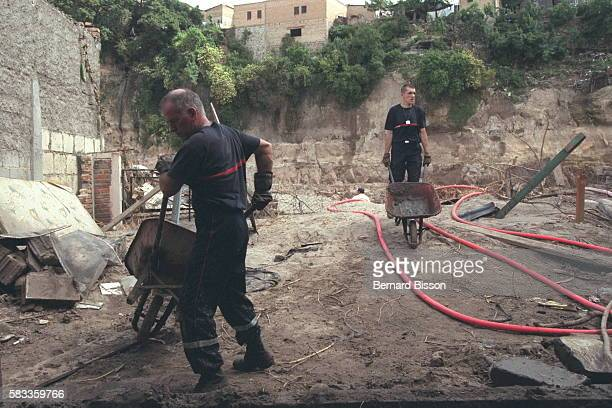 French firemen working to clean up the capital