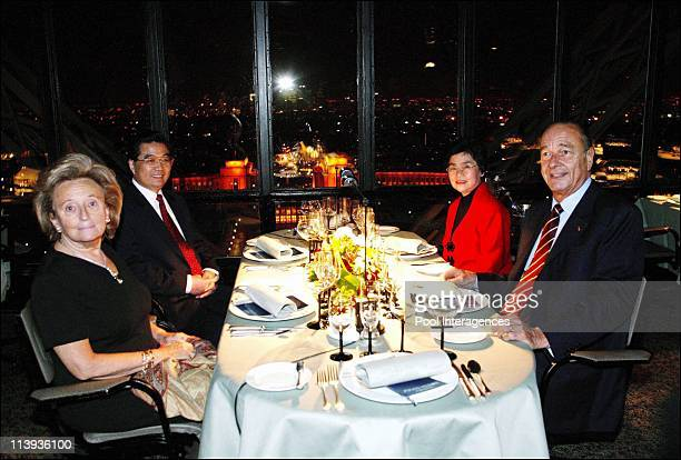 French first lady Bernadette Chirac Chinese President Hu Jintao Chinese first lady Liu Yongging and French President Jacques Chirac pose at their...