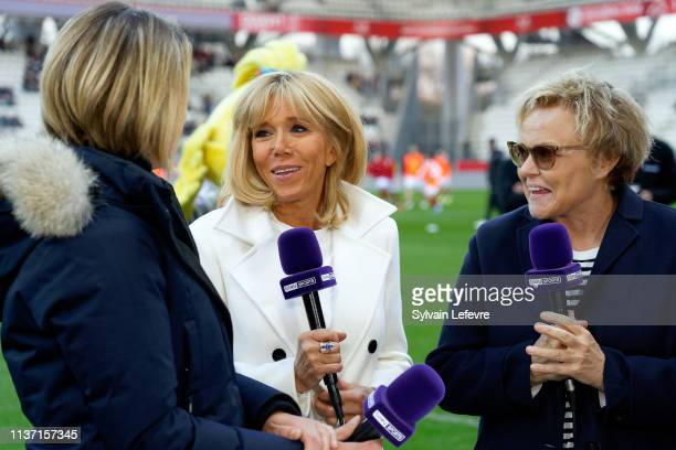 French First Lady Brigitte Macron and Muriel Robin speak with journalist as they attend the Varietes Club De France Vs Reims Charity Match on March...