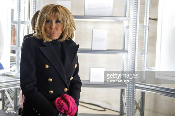 "French First Lady Brigitte Macron attends the ""Detenus"" Bettina Rheims exhibition opening at Chateau De Vincennes on February 8, 2018 in Paris,..."