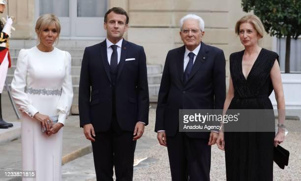 French first lady Brigitte Macron, French President Emmanuel Macron, Italian President Sergio Mattarella and his daughter Laura Mattarella pose...