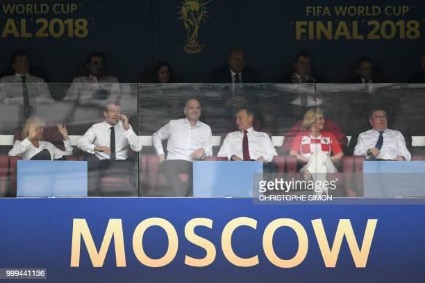 TOPSHOT French first lady Brigitte Macron French President Emmanuel Macron FIFA president Gianni Infantino Russian President Vladimir Putin Croatian...