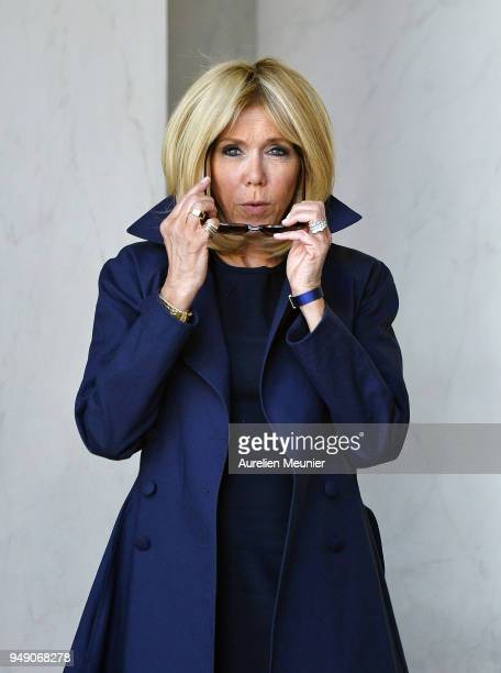 French First Lady Brigitte Macron leaves the Elysee Palace to attend the tribute to fallen police officer Xavier Jugele on April 20 2018 in Paris...