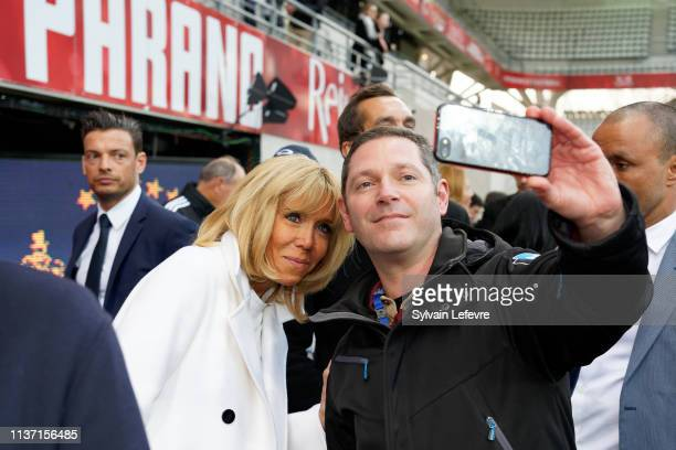 French First Lady Brigitte Macron poses for selfie as she attends the Varietes Club De France Vs Reims - Charity Match on March 20, 2019 in Reims,...