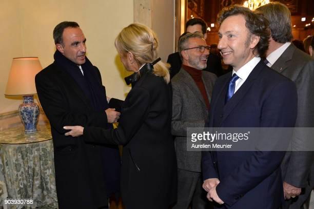 French First Lady Brigitte Macron salutes Nikos Aliagas as she attends the Prix Histoire et Prix Patrimoine 2017 de La Fondation Stephane Bern at...