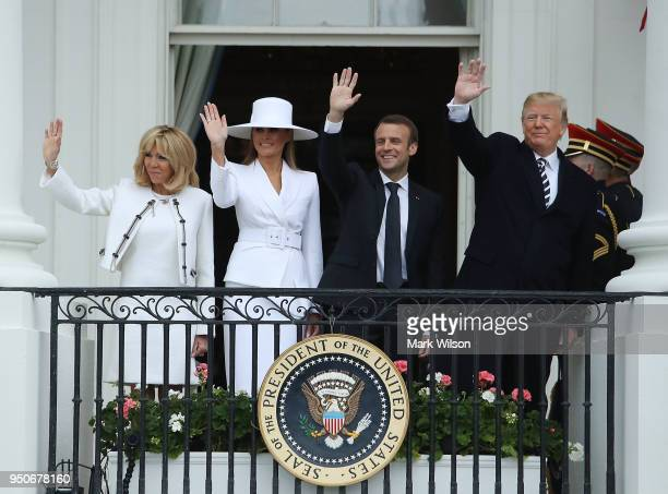 French first lady Brigitte Macron US first lady Melania Trump French President Emmanuel Macron and US President Donald Trump wave during a state...