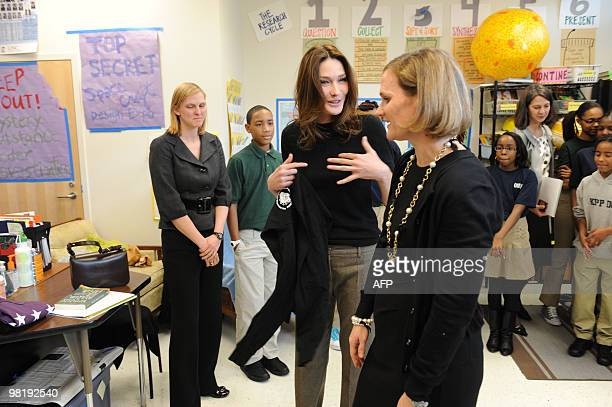 French First Lady Carla Bruni Sarkozy talks with teacher Susan Schaeffer as she visits at a KIPP school a school for underprivileged pupils on March...