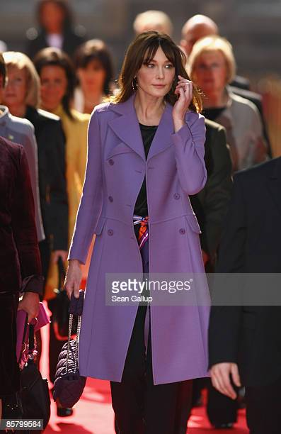 French First Lady Carla BruniSarkozy accompanies spouses of NATO member state leaders at Rohan Palace on April 4 2009 in Strasbourg France The...