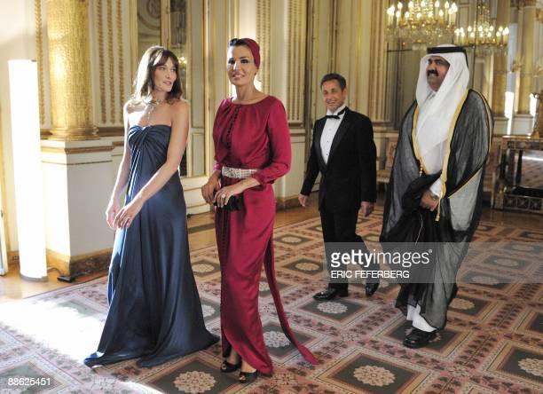 French First Lady Carla Bruni-Sarkozy , Qatar's First Lady Sheikha Mozah Bint Nasser Al-Misned , French President Nicolas Sarkozy and Qatari Emir...