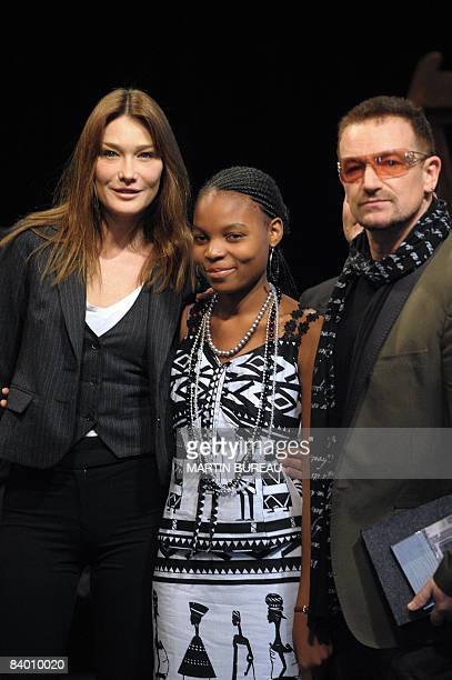 French First Lady Carla BruniSarkozy Tandiwe Chama Recepient of the International Children's Peace Prize 2007 and U2 Rock band singer Bono pose for...