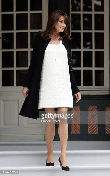 French first lady Carla Bruni-Sarkozy waits for the spouses of the Heads of Delegation participating in the G8 Summit on May 26, 2011 in Deauville,...