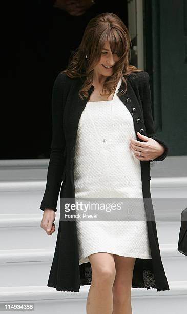 French first lady Carla BruniSarkozy waits for the spouses of the Heads of Delegation participating in the G8 Summit on May 26 2011 in Deauville...