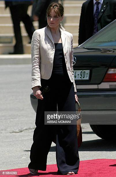 French First Lady Carla BruniSarkozy walks during a welcoming ceremony for her and her husband French President Nicolas Sarkozy at Palestinian...