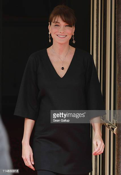 French First Lady Carla BruniSarkozy who is pregnant stands outside Le Ciro's Resaturant before lunch with the spouses of heads of state on the...