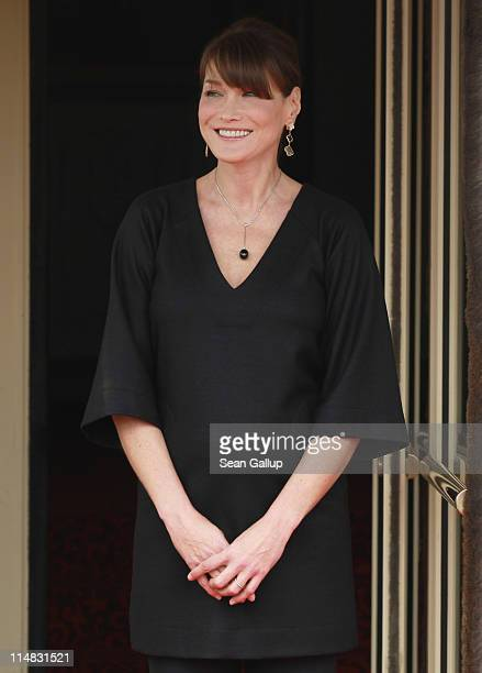 French First Lady Carla BruniSarkozy who is pregnant stands outside Le Ciro's Resaturant while waiting for the spouses of heads of state before lunch...