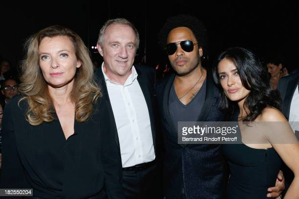 French First Lady Valerie Trierweiler FrancoisHenri Pinault Lenny Kravitz and Salma Hayek attend Saint Laurent show as part of the Paris Fashion Week...