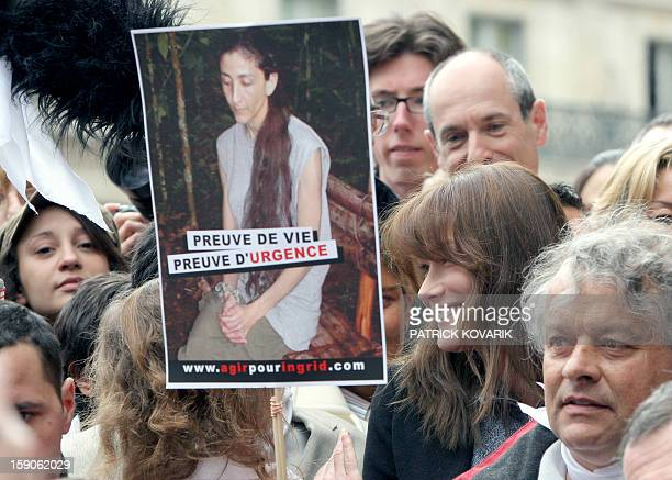 French first wife Carla Bruni Sarkozy takes part in a solidarity marche on April 6 2008 in Paris calling for the release of French Colombian hostage...