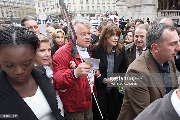 French first wife Carla BruniSarkozy and Fabrice Delloye former husband of French Colombian hostage Ingrid Betancourt take part in a Solidarity...