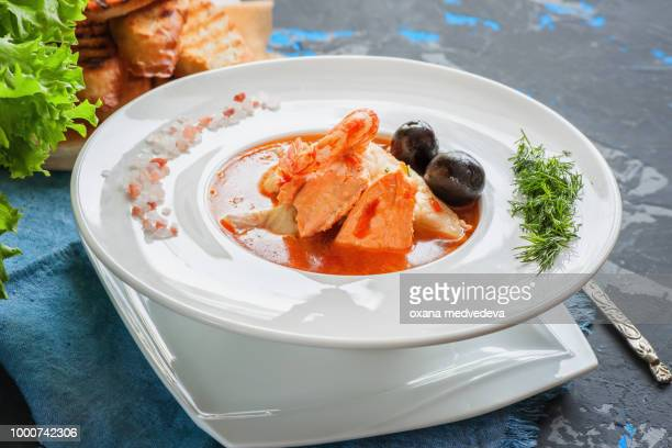 French fish soup Bouillabaisse with seafood, salmon fillet, shrimp, rich flavor, delicious dinner...