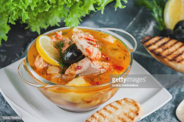 French fish soup Bouillabaisse with seafood, salmon fillet, shrimp with a rich flavor, with...