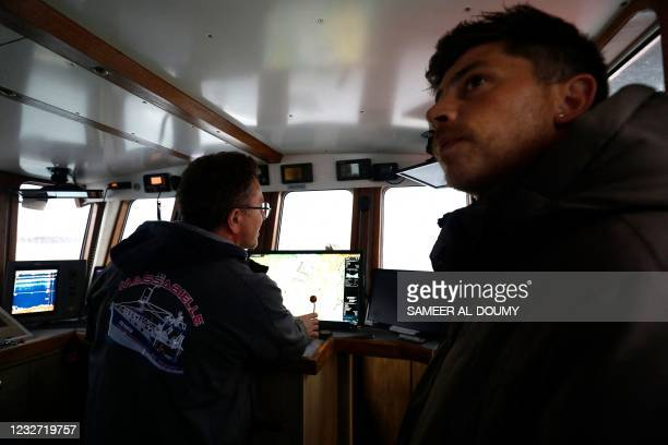 French fishermen protest on their boat in front of the port of Saint Helier off the British island of Jersey to draw attention to what they see as...