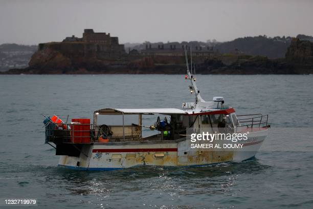 French fishing boat, one of several boats, protest in front of the port of Saint Helier off the British island of Jersey to draw attention to what...