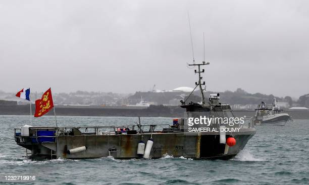 French fishing boat, one of several, takes part in a protest in front of the port of Saint Helier off the British island of Jersey to draw attention...