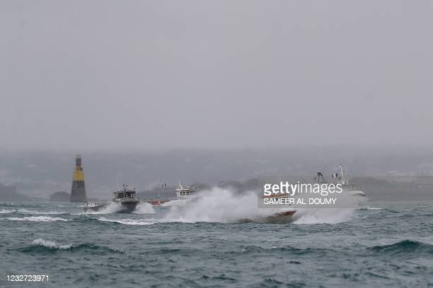 French fishing boats leave the Jersey waters following their protest in front of the port of Saint Helier off the British island of Jersey to draw...