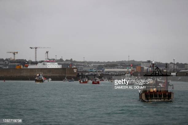 French fishing boats protest in front of the port of Saint Helier off the British island of Jersey to draw attention to what they see as unfair...