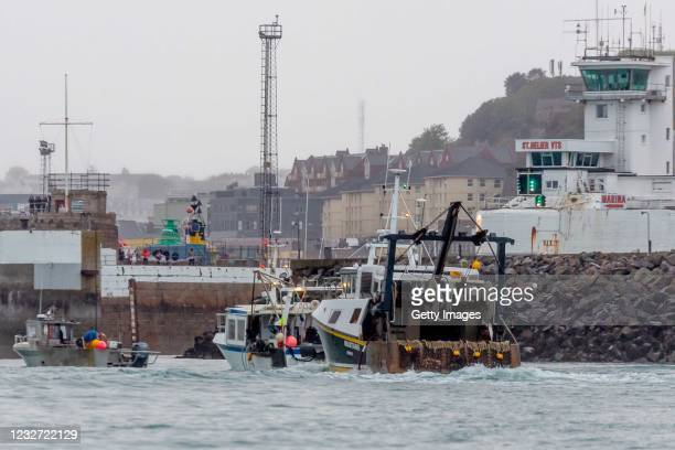 French fishing boats sail into the harbour in protest against the new fishing licences on May 6, 2021 in St Helier, Jersey. Up to 80 French fishing...