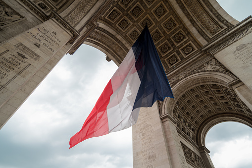 french flag during bastille day in paris at Arc de Triomphe 901649860