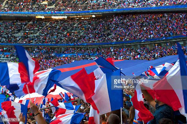 French Flag held up by fans at stadium