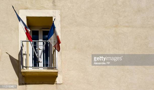 french flag hung on villecroze city hall window - town hall stock pictures, royalty-free photos & images