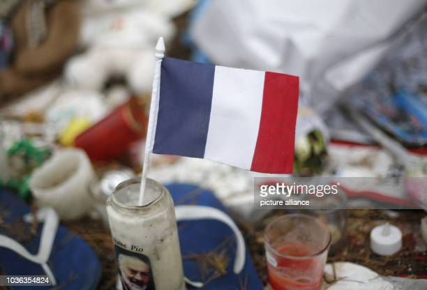 A french flag in a candle on the 'Promenade des Anglais' in Nice France 14 September 2016 A 31yearold Tunisian man had driven into a crowd on the...