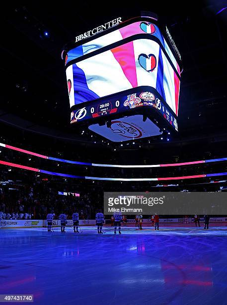 French flag is displayed during a game between the Florida Panthers and the Tampa Bay Lightningduring a game at BBT Center on November 16 2015 in...