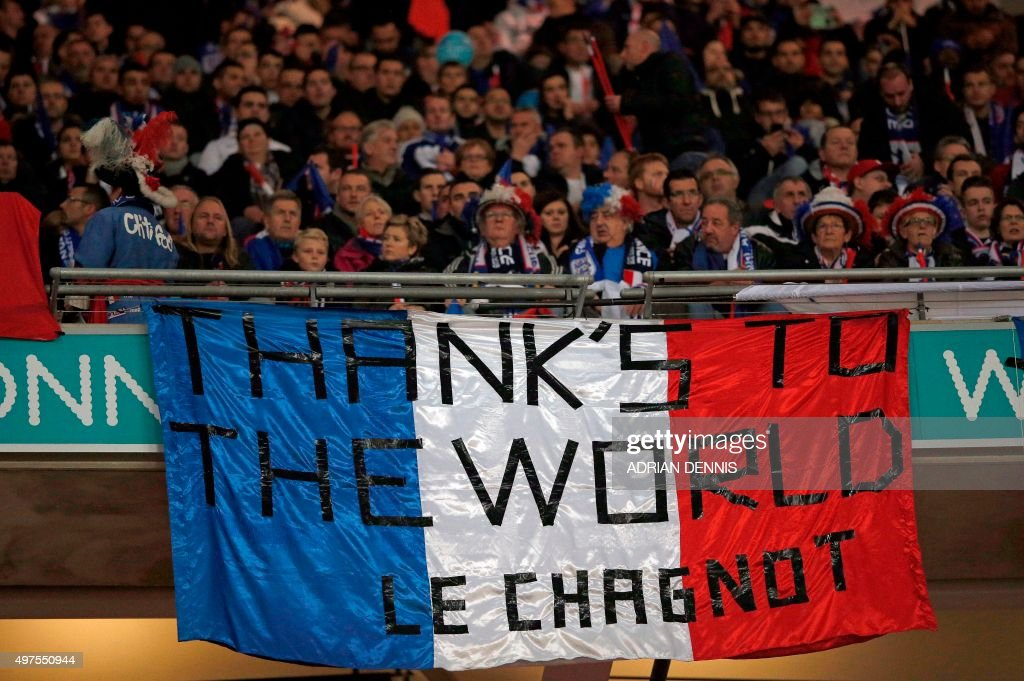 A French flag is pictured as fans gather for the start of the friendly football match between England and France at Wembley Stadium in west London on November 17, 2015.