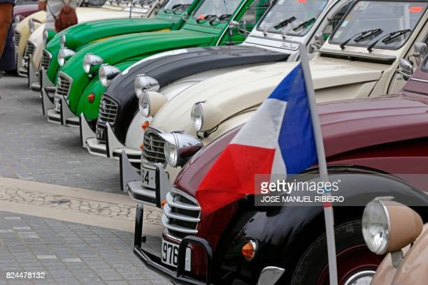 French flag is pictured in the parking area in Mafra after the parade of the World 2017 2CV Meeting July 30, 2017. - The event is held between the...