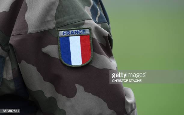 A French flag is seen at a soldier uniform during the exercise 'Strong Europe Tank Challenge 2017' at the exercise area in Grafenwoehr near...