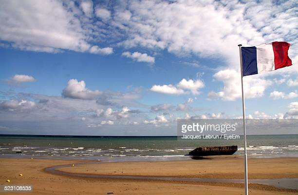 French Flag On Sandy Beach